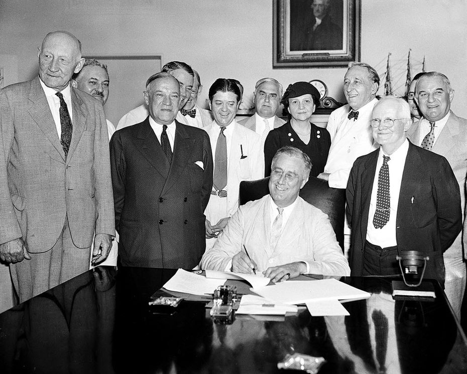 In this Aug. 14, 1935, file photo President Franklin Roosevelt signs the Social Security bill in Washington.