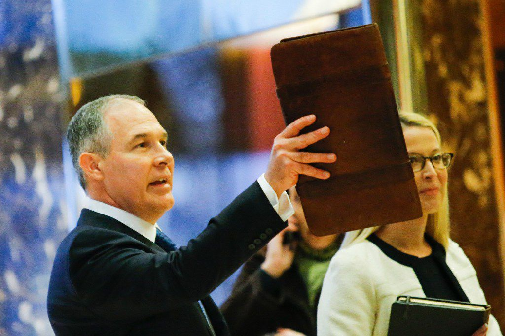 Oklahoma Attorney General Scott Pruitt, who is President-elect Donald Trump's choice to lead the Environmental Protection Agency, was part of a mostly Republican coalition of attorneys general — including former Texas AG Greg Abbott — that frequently sued President Barack Obama's EPA. (Eduardo Munoz Alvarez/Agence France-Presse)