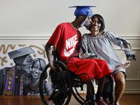Like the painting of them by artist Chris Rayson, Corey Borner gives his mother, Charlotte Borner, a kiss. The former DeSoto football player, paralyzed during a practice in 2009, always vowed that he would walk again. Last month, he walked across the stage with the aid of an exoskeleton suit to receive his degree from UNT-Dallas.