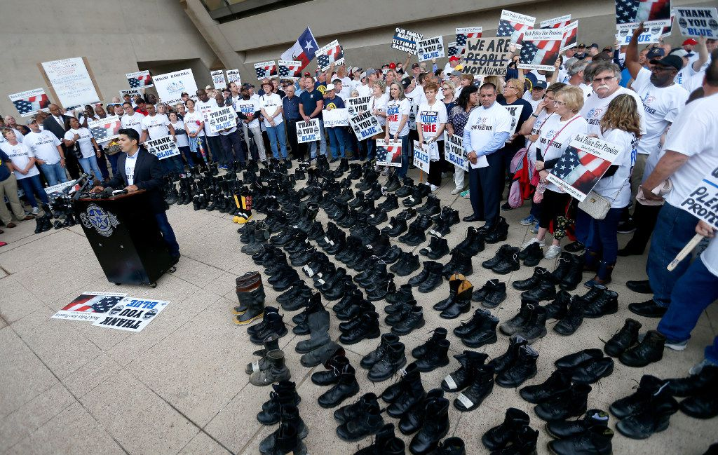 At a protest in front of Dallas City Hall this morning, past and present Dallas police and firefighters called on Dallas Mayor Mike Rawlings to stop fighting the pension fund fix currently being debated in the state Legislature. (Jae S. Lee/The Dallas Morning News)