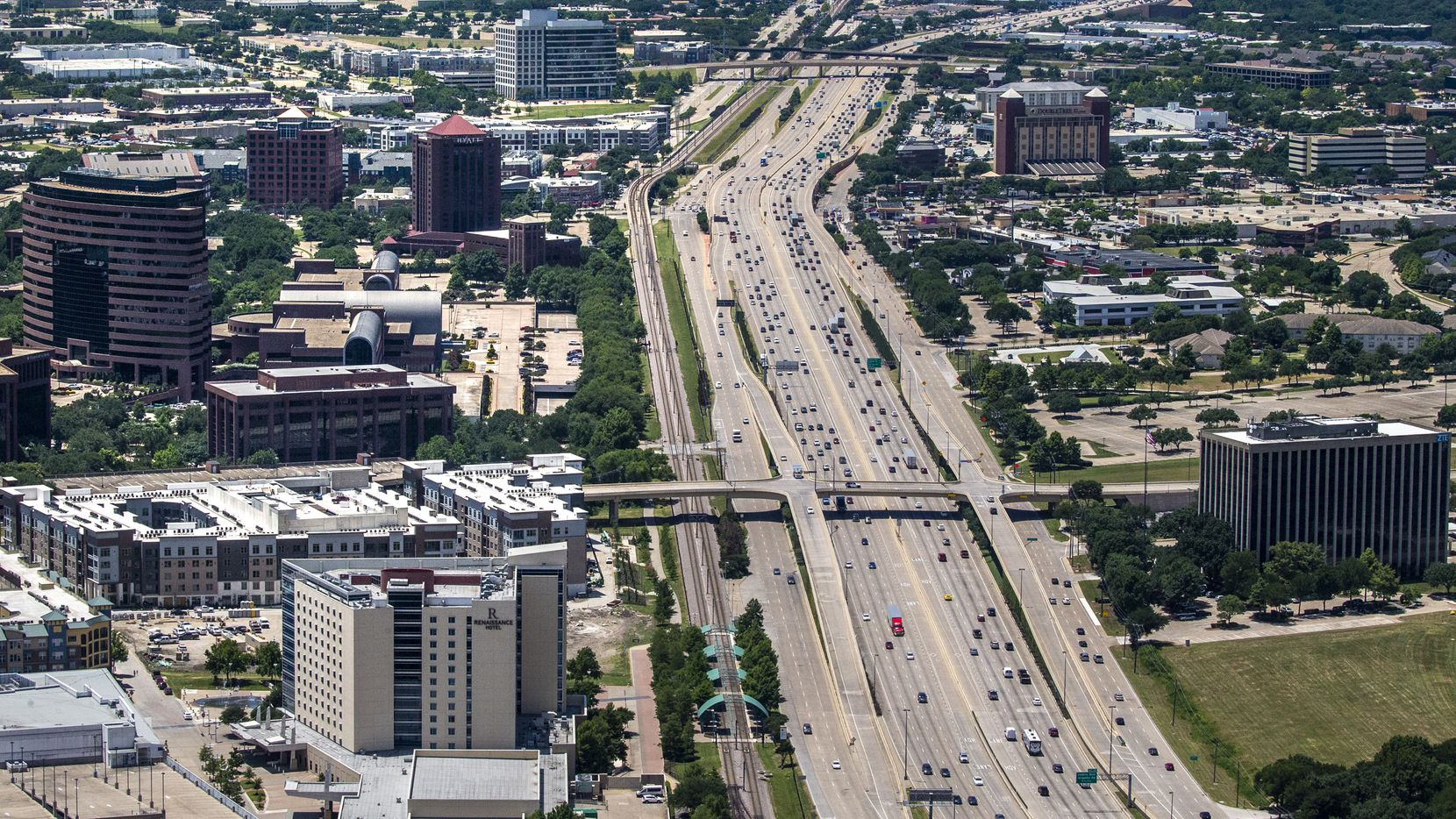Vehicles travel on U.S. Highway 75 in Richardson in this June file photo. The city is asking residents to weigh in on the branding and redesign of two districts east of the highway that are being targeted for redevelopment.
