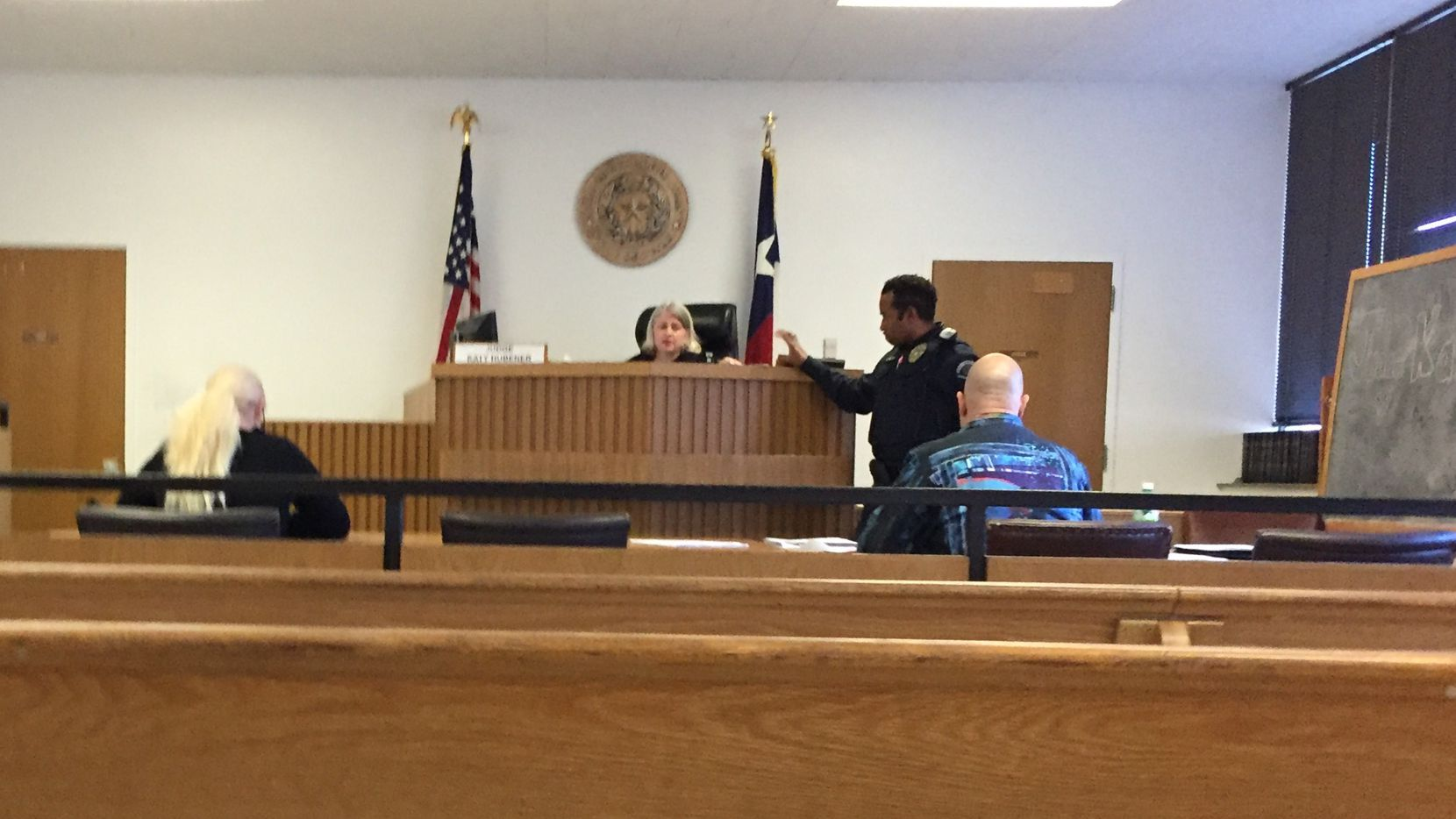 In Judge Katy Hubener's Irving small claims court, Irving waitress Christal Scott (left) sued David A. Kost Jr. (right) for $7,500 in a used-car dispute.