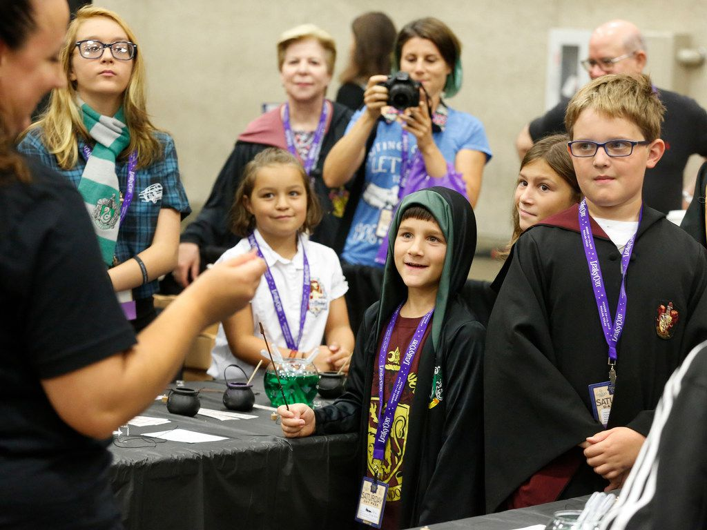 Children watch a potion demonstration at LeakyCon, the Harry Potter fan convention held at the Kay Bailey Hutchison Convention Center in Dallas on Saturday, August 11, 2018.
