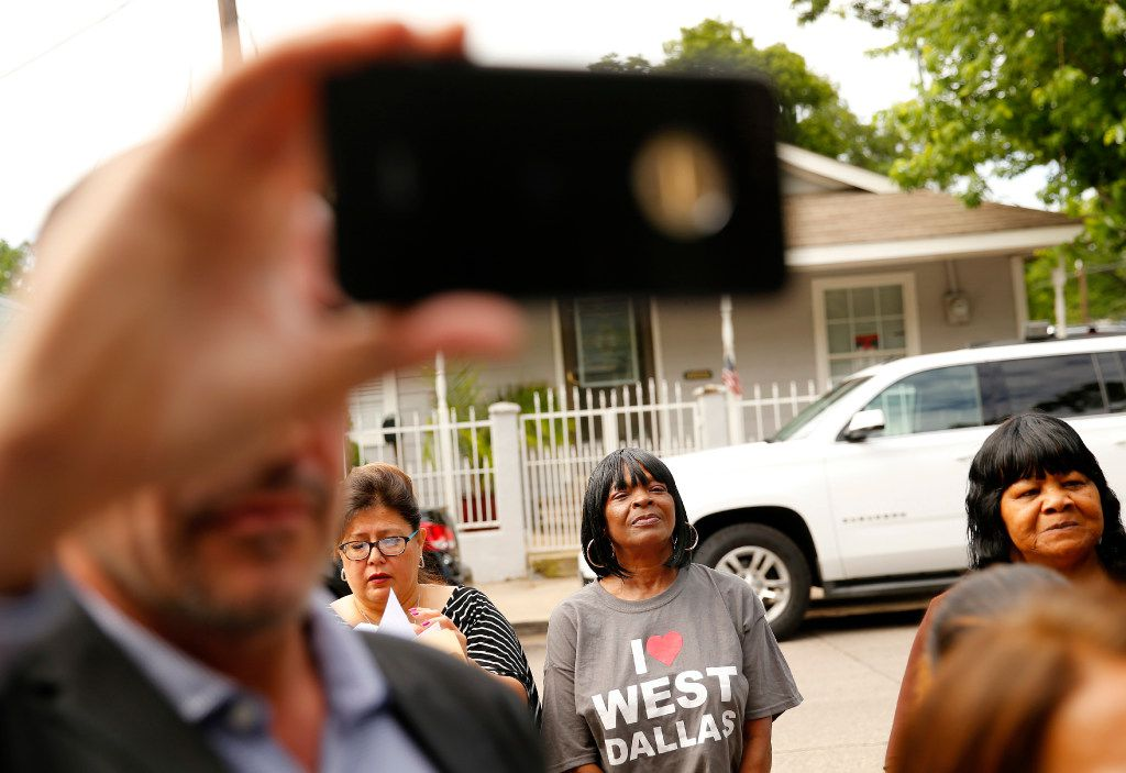 West Dallas residents and supporters came to hear HMK landlord Khraish Khraish announce at a press conference that he's changed his mind and is deciding to sell homes to their West Dallas tenants for $65,000, Monday, May 22, 2017.
