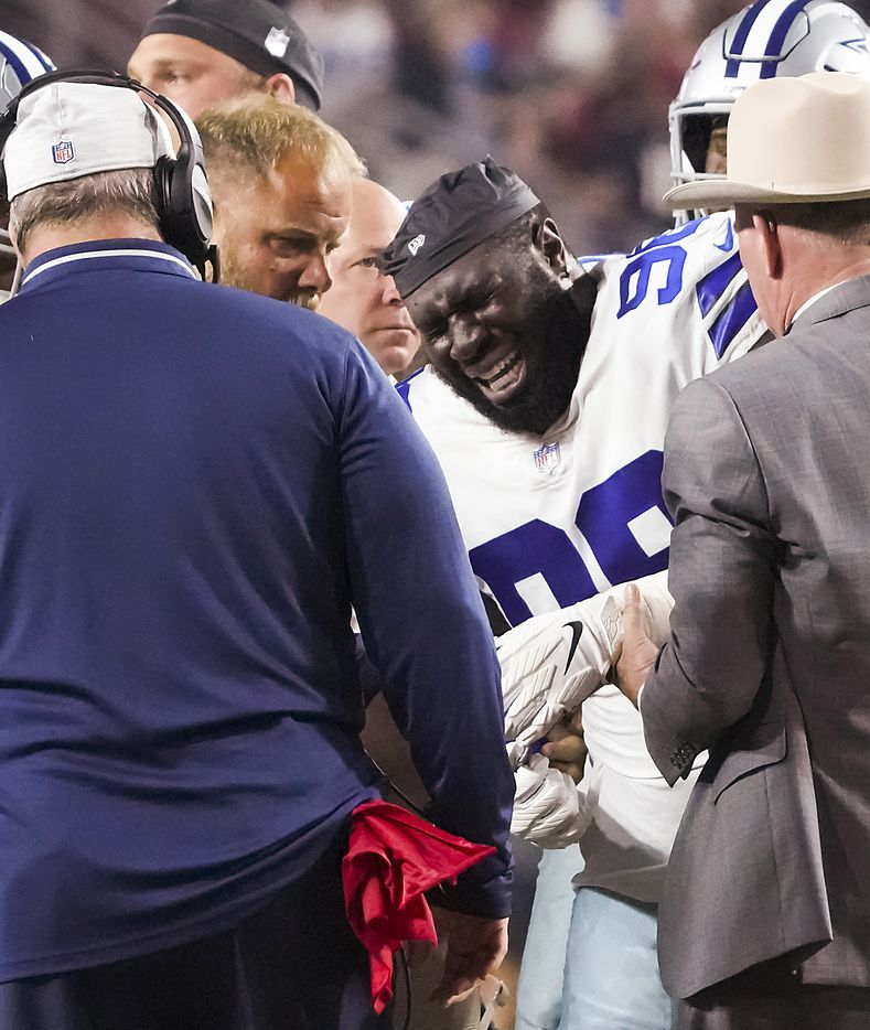 Dallas Cowboys defensive tackle Neville Gallimore (96) receives medical attention after being injured during the first quarter of an NFL football game at State Farm Stadium on Friday, Aug. 13, 2021, in Glendale, Ariz.