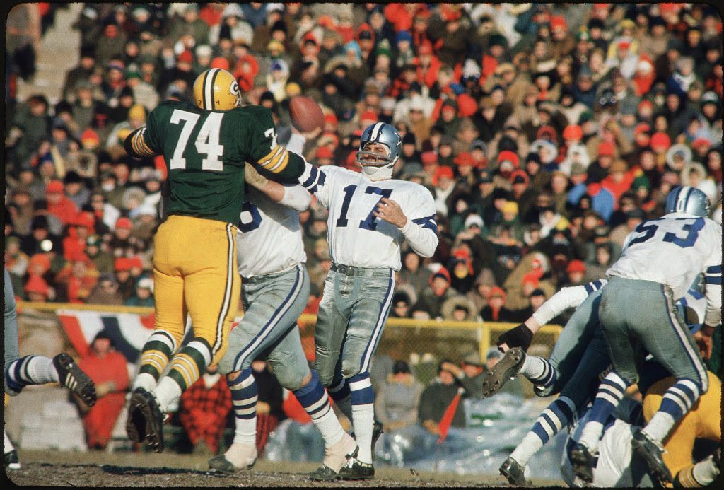 Don Meredith throwing a pass against the Green Bay Packers in the famous Ice Bowl game, played in Wisconsin in December of 1967.