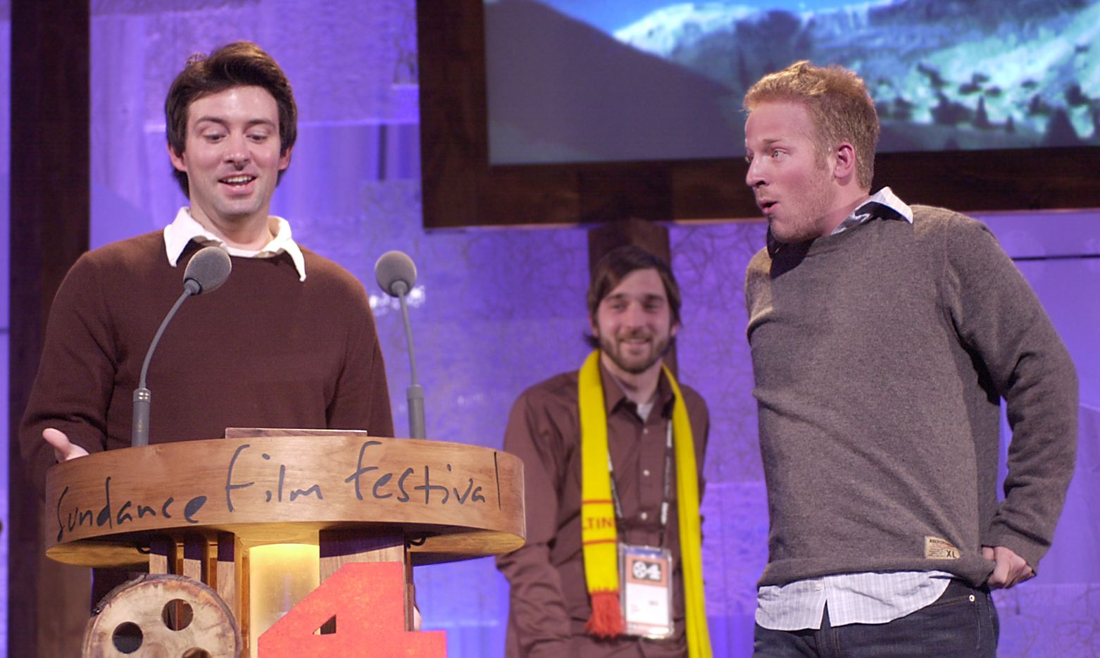 """Shane Carruth accepts the dramatic Grand Jury award for the film """"Primer"""" on Jan. 24, 2004, at the Sundance Film Festival awards show in Park City, Utah. Actors, and crew members Casey Gooden, center, and David Sullivan, right, look on."""