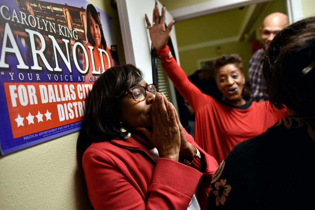 Candidate Carolyn King Arnold reacts as she's announced the winner of the Dallas City Council District 4 runoff between herself and Keyaira Saunders,  on Dec. 11, 2018, at Arnold's headquarters in Dallas. At right is supporter Bobbie McGee.