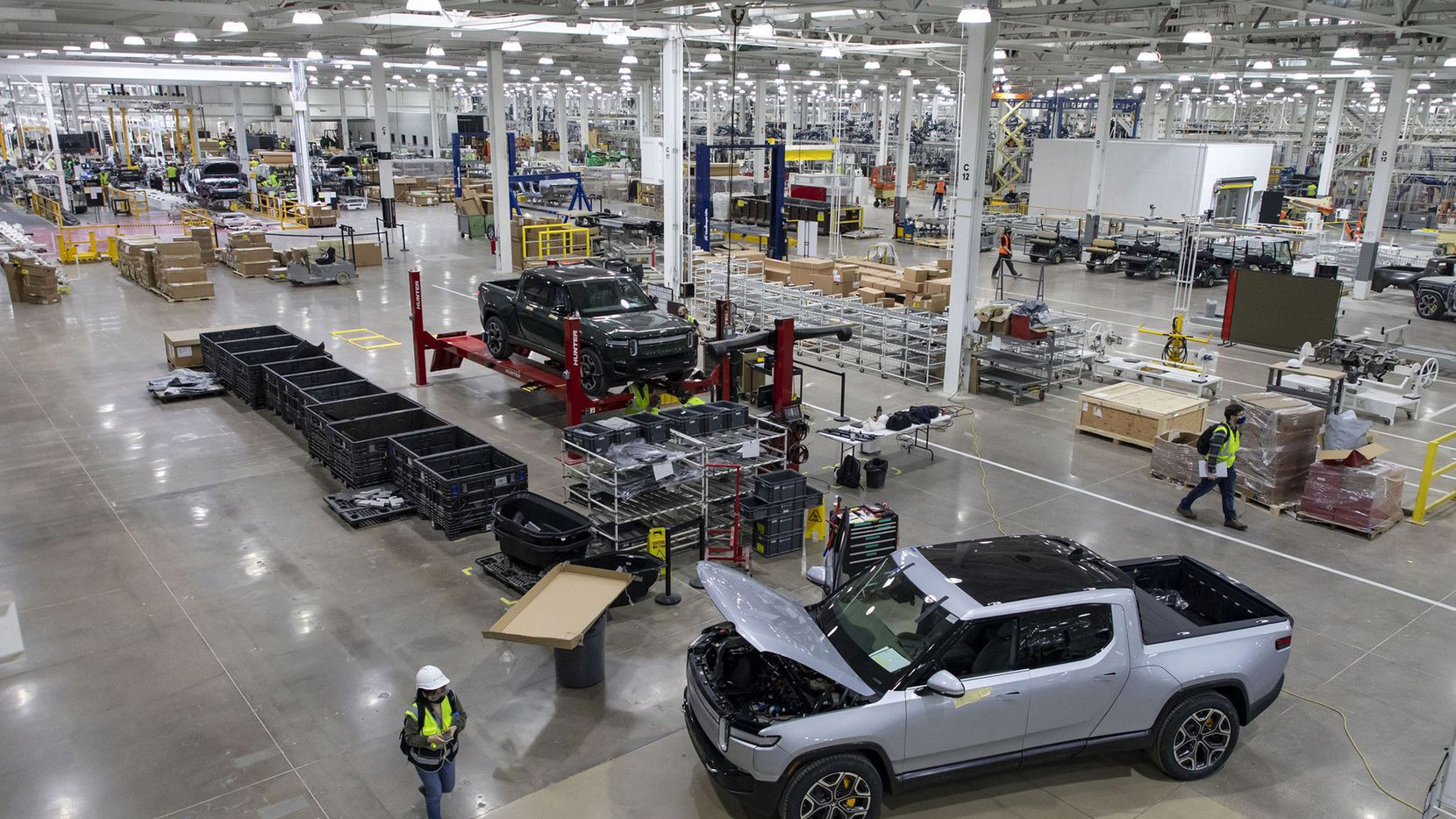 Rivian's RT1 trucks are assembled and tested at the company's first plant in Normal, Ill.
