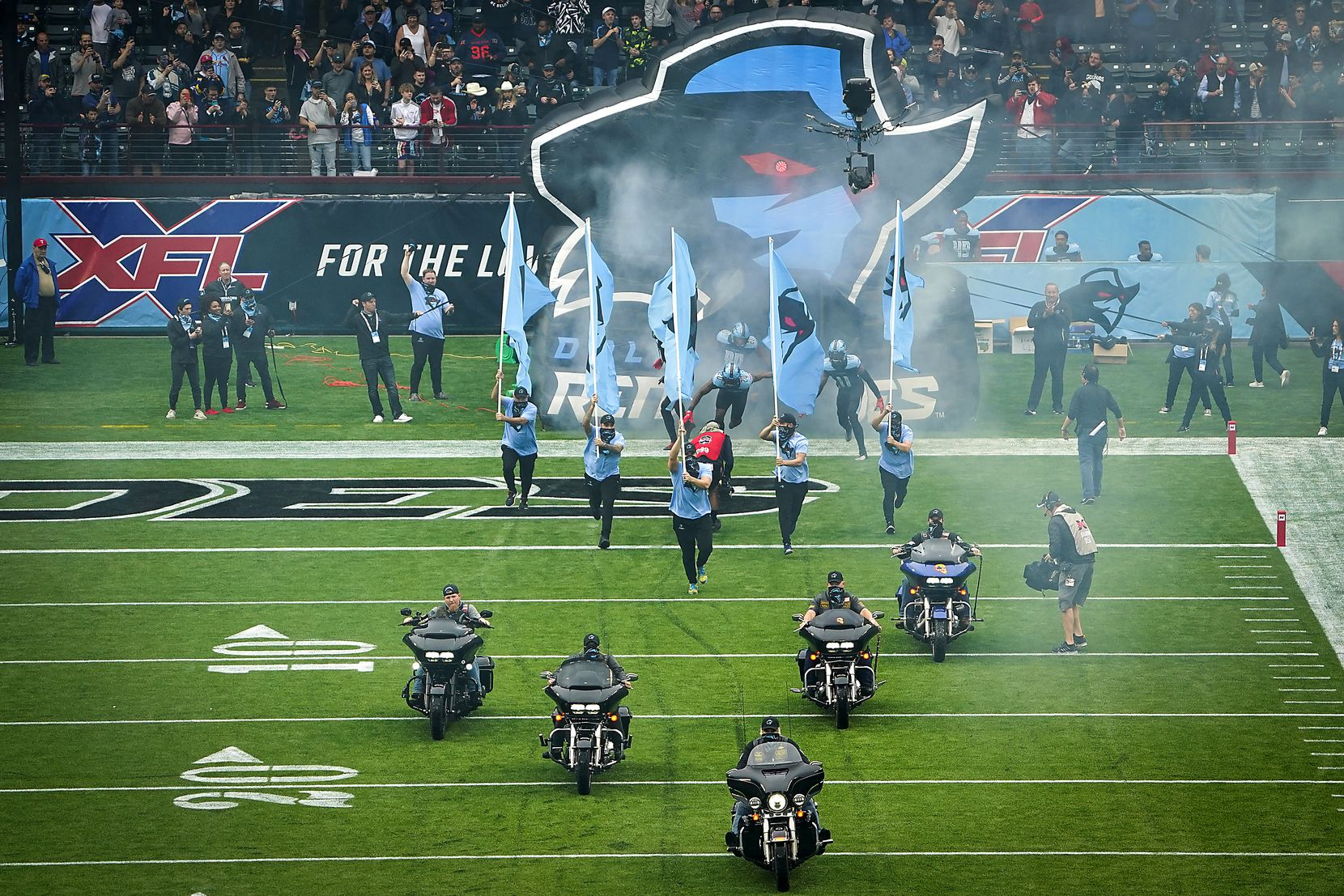 Dallas Renegades player take the field for the team's inaugural XFL football game against the St. Louis Battlehawks at Globe Life Park on Sunday, Feb. 9, 2020, in Arlington.