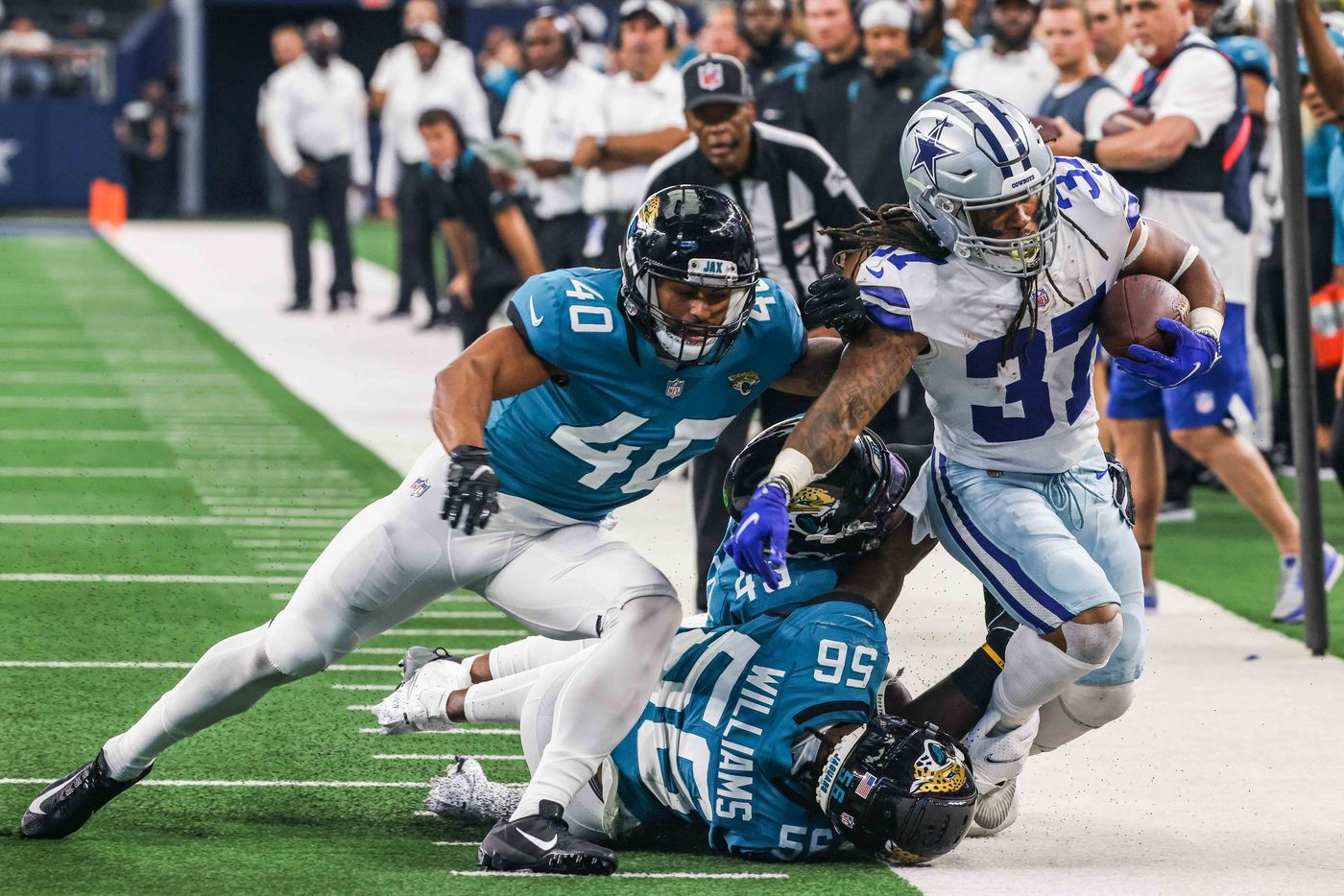 Dallas Cowboys running back JaQuan Hardy, 37, gets pushed out of the sideline by Jacksonville Jaguars defense during a preseason game at AT&T stadium in Arlington on Sunday, August 29, 2021. (Lola Gomez/The Dallas Morning News)