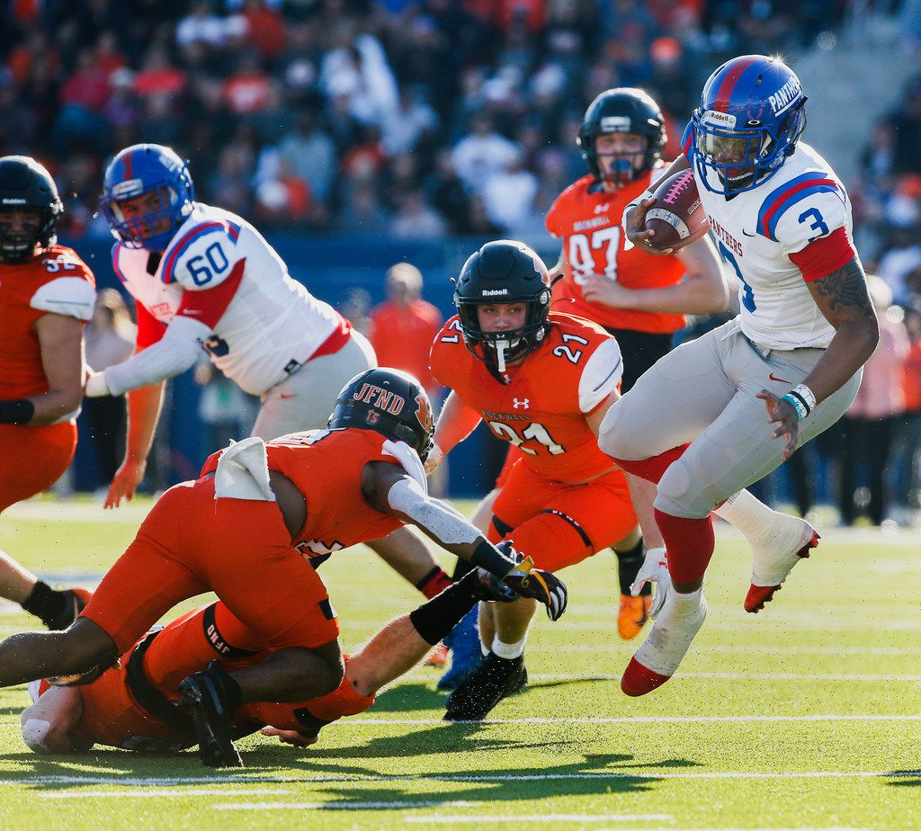 Duncanville quarterback Ja'Quinden Jackson (3) evades a swarm of Rockwall defenders during the first half of a Class 6A Division I state semifinal football matchup between Rockwall and Duncanville on Saturday, Dec. 14, 2019 at McKinney ISD Stadium in McKinney, Texas. (Ryan Michalesko/The Dallas Morning News)