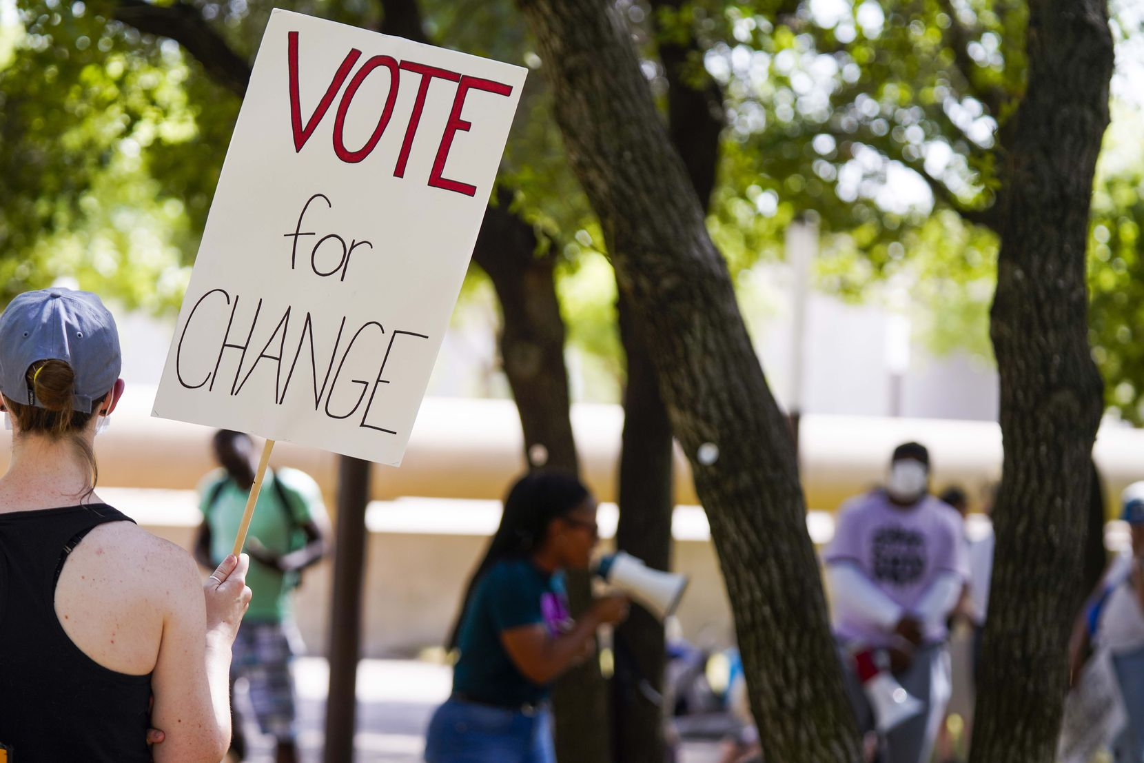 "A woman held a sign reading ""Vote for Change"" during a rally organized by Not My Son at Dallas City Hall on June 9."