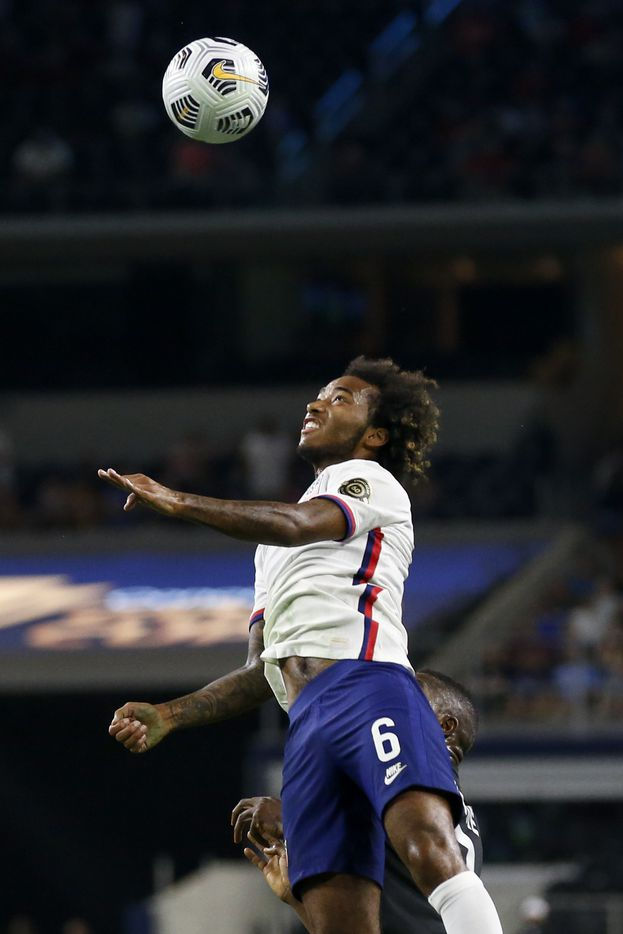 USA midfielder Gianluca Busio (6) leaps for a ball during the first half of a CONCACAF Gold Cup quarterfinal soccer match against Jamaica at AT&T Stadium on Sunday, July 25, 2021, in Arlington. (Elias Valverde II/The Dallas Morning News)