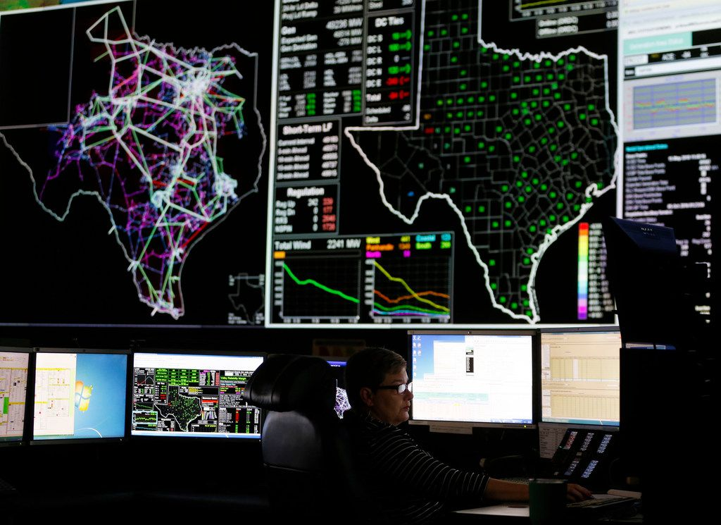 System operators work in the command center of the Electric Reliability Council of Texas in Taylor.