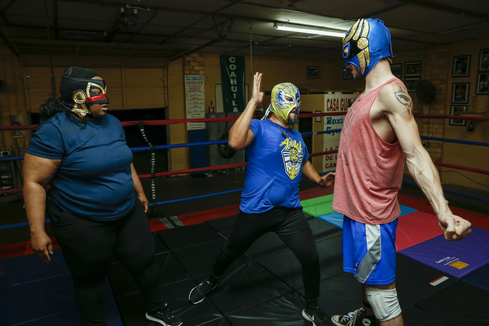 """Tiffany Lang as Coyol watches as fight coordinator Aski the Mayan Warrior, center, demonstrates a slap on Dylan Cantu as Huitzi during a rehearsal of """"Lucha Teotl"""" at Casa Guanajuato."""