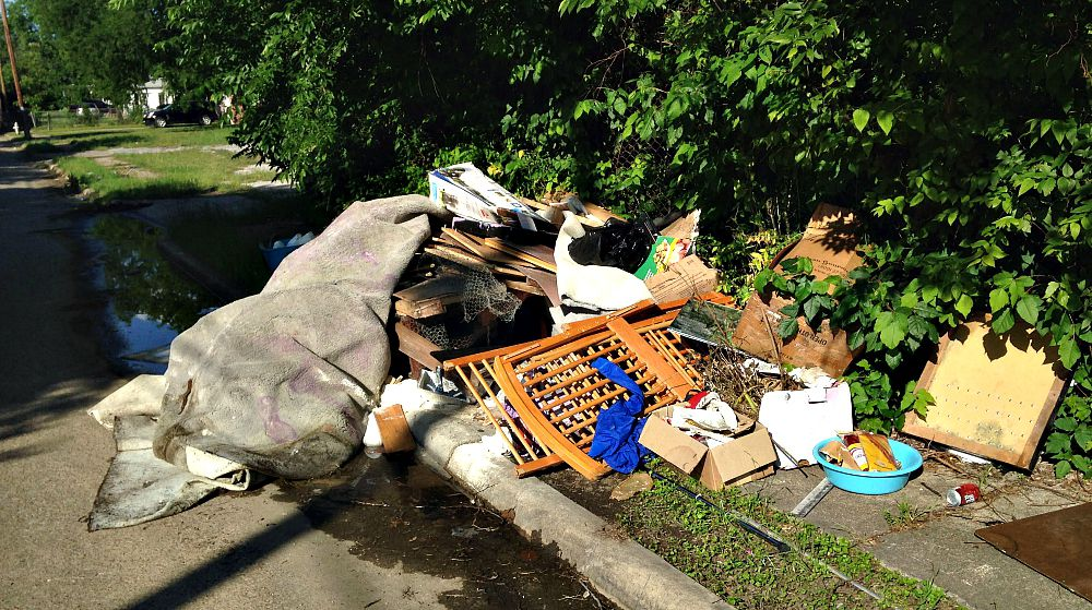 Trash heaps like this one along Herrling Street off Second Avenue in South Dallas are far too common.