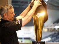FILE - Trophy manager Charley Green sets up the national championship trophy during Big 12 football media days in the Ford Center at The Star in Frisco on Monday, July 17, 2017.