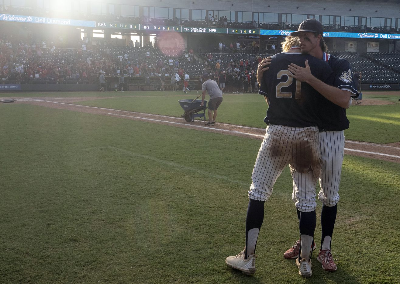 Keller Eric Hammond, (27),  gives teammate, Zach Rike, (21), a hug after coming up short against Rockwall-Heath during the 2021 UIL 6A state baseball final held, Saturday, June 12, 2021, in Round Rock, Texas.  Rockwall-Heath defeated Keller 4-3.   (Rodolfo Gonzalez/Special Contributor)