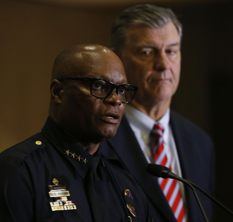 Dallas Police Chief David Brown (left) and Mayor Mike Rawlings spoke at a City Hall news conference in the early morning of July 8, 2016, the day after five officers were ambushed downtown.