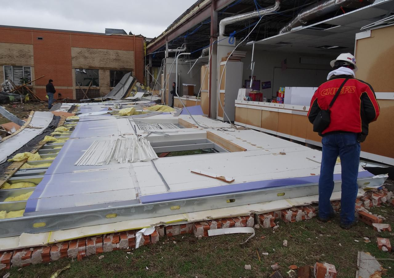 """Storm damage to Donald T. Shields Elementary school, (part of Red Oak ISD), shown Dec. 28 in Glenn Heights after tornadoes tore across North Texas two days earlier. Timothy P. Marshall (not pictured) is a consultant who focuses on wind damage and construction defect evaluations, among other things. He is participating in a damage survey team with the National Weather Service. As he surveyed the damage at Donald T. Shields Elementary in Glenn Heights, he posted this to his Facebook account: """"one of several walls that fell outward at this school. Walls were not attached to the steel frame and only had small nails to secure them into the concrete foundation. Thus, walls were in essence free-standing."""""""