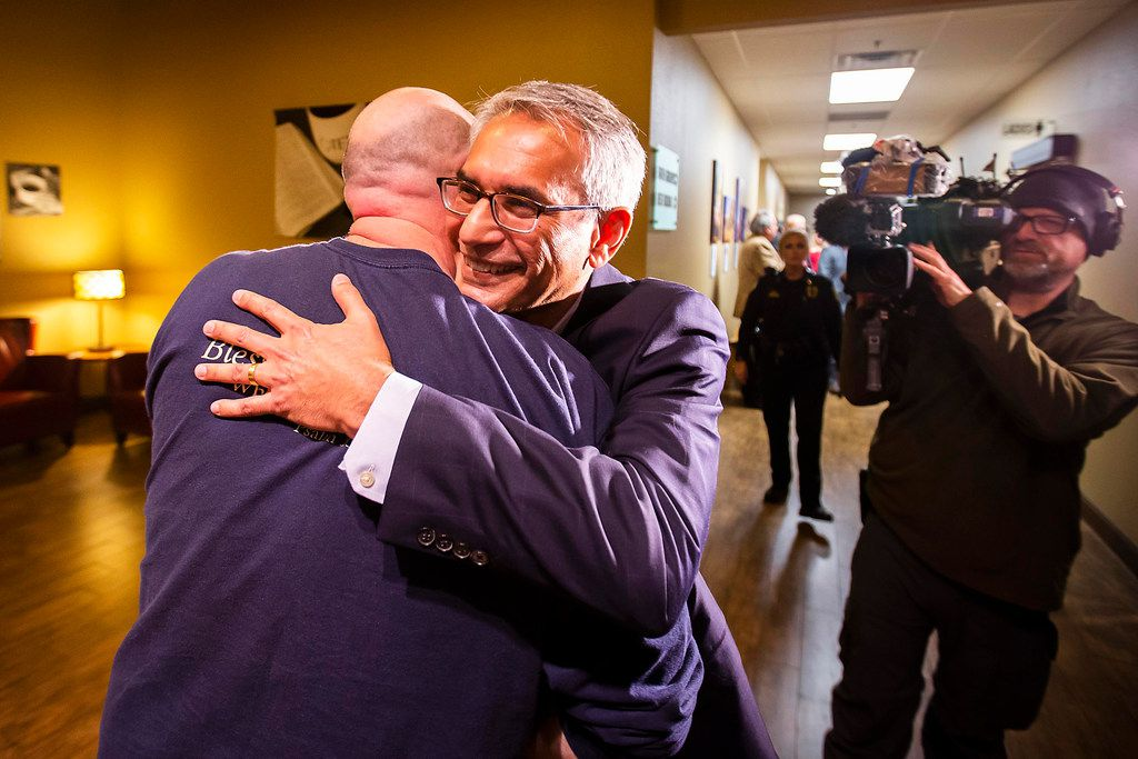 Tarrant County Republican Party  vice chair Dr. Shahid Shafi hugs a supporter after a meeting of the county party executive committee at Faith Creek Church Thursday, Jan. 10, 2019, in Richland Hills, Texas. The county party voted to keep Shafi in his position after some party members accused Shafi of believing in Shariah over American law because of his religion. (Smiley N. Pool/The Dallas Morning News)