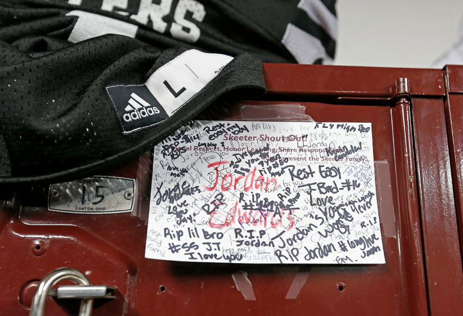 A name card for Jordan Edwards signed by teammates is attached to his locker at Mesquite High School in Mesquiteon Tuesday. Edwards, a freshman football player at Mesquite High School, was shot and killed by a Balch Springs police officer Saturday night.