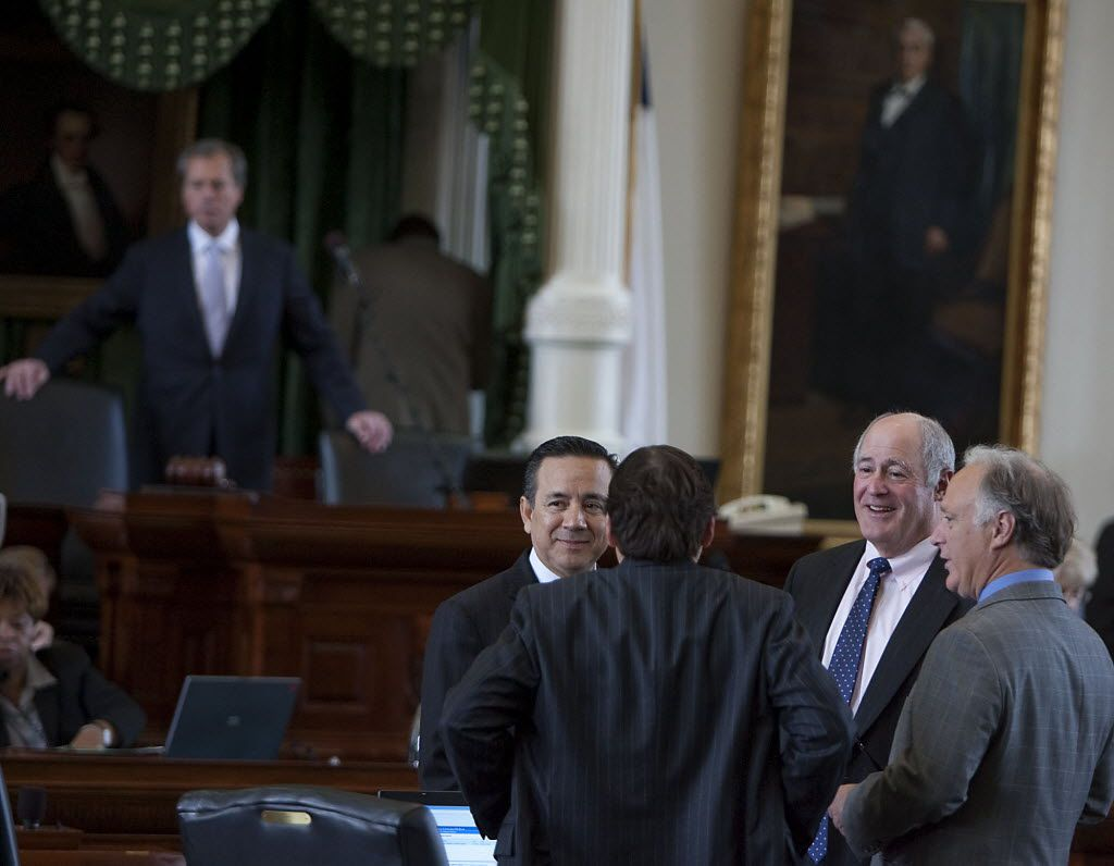 Former Texas Sen. Carlos Uresti (left), shown with colleagues at the state Capitol in 2011, was found guilty of 11 felonies, including fraud and money laundering.