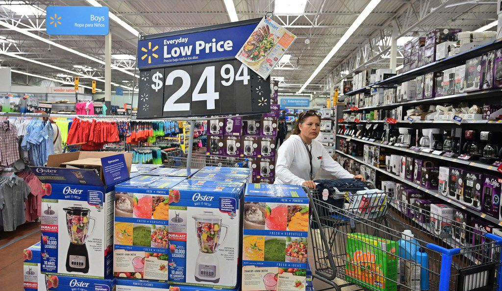 A woman shops at a Walmart Supercenter store in Rosemead, Calif., on May 23, 2019. Walmart has said it will raise prices as a result of the Trump administration's tariffs on Chinese-made goods as the trade war is about to take a bite into the retail sector.