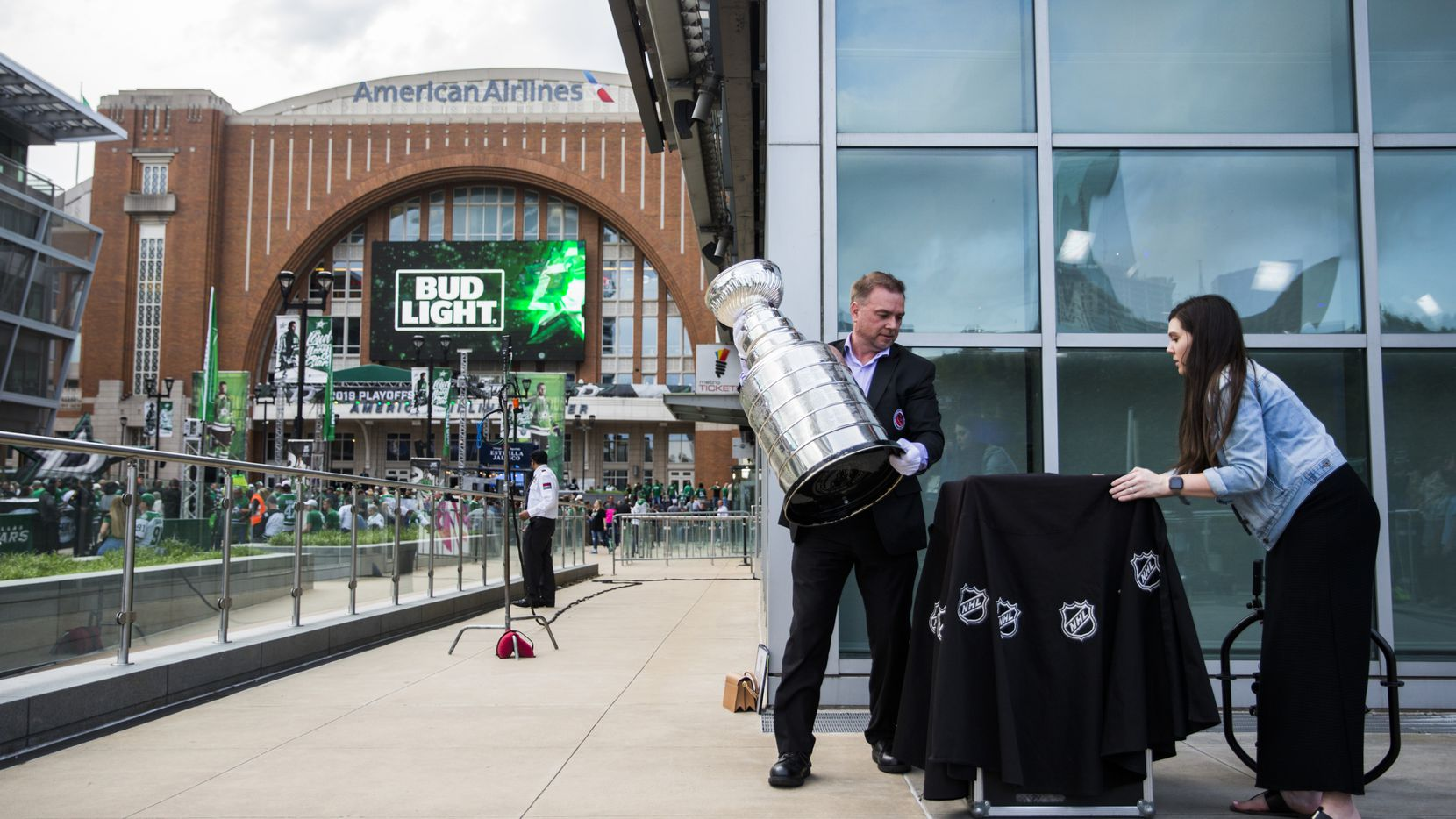Stanley Cup keeper Howie Borrow (center) and Lauren Montgomery (right) of Allied Global Marketing set up the Stanley Cup outside American Airlines Center before Game 6 of the first round of Stanley Cup Playoffs between the Dallas Stars and the Nashville Predators on Monday, April 22, 2019 in Dallas.