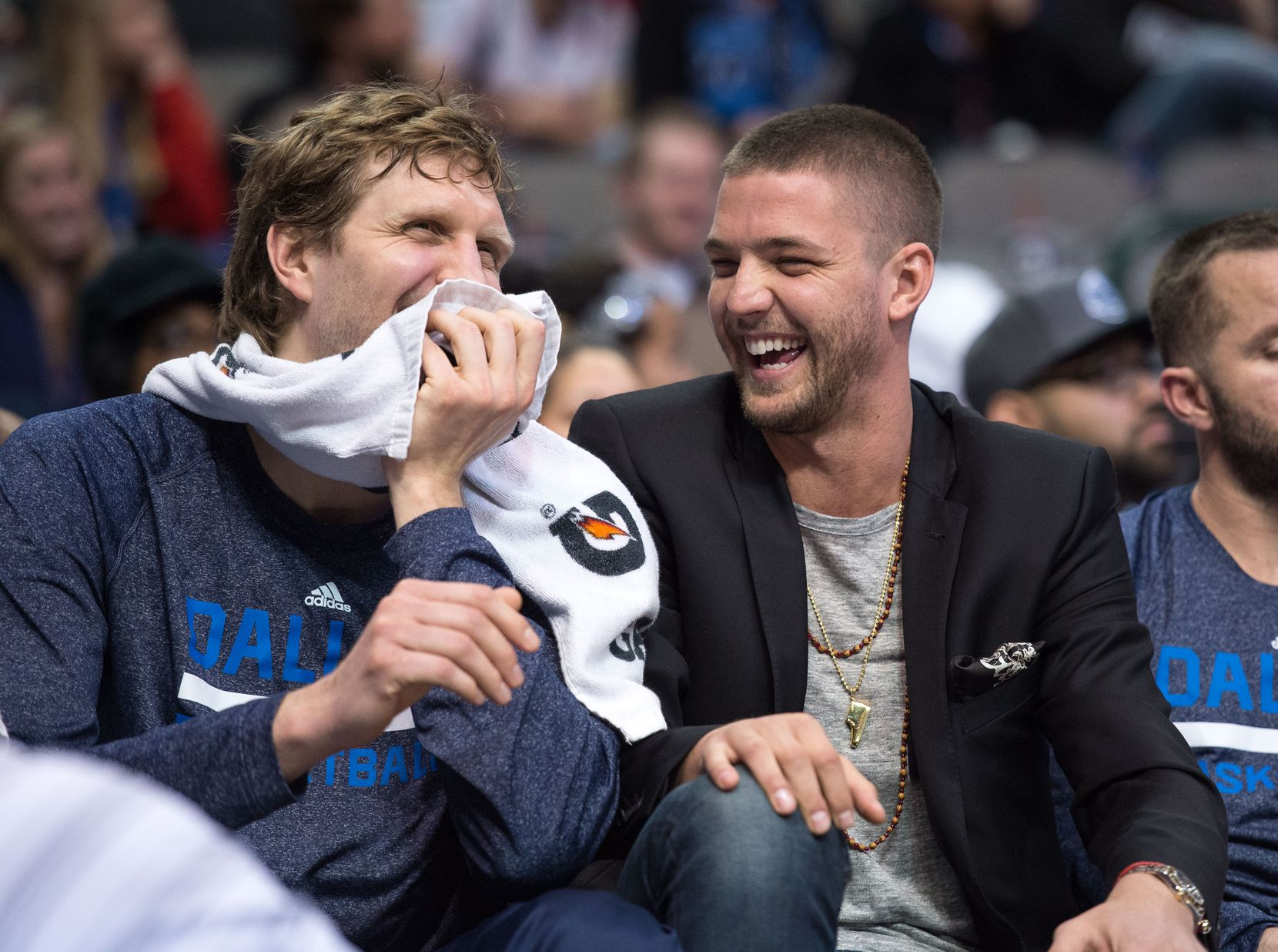 Feb 22, 2015; Dallas, TX, USA; Dallas Mavericks forward Dirk Nowitzki (41) and forward Chandler Parsons (25) share a laugh on the bench during the second half of the game between the Mavericks and the Charlotte Hornets at the American Airlines Center. The Mavericks defeated the Hornets 92-81. Mandatory Credit: Jerome Miron-USA TODAY Sports 05052015xSPORTS