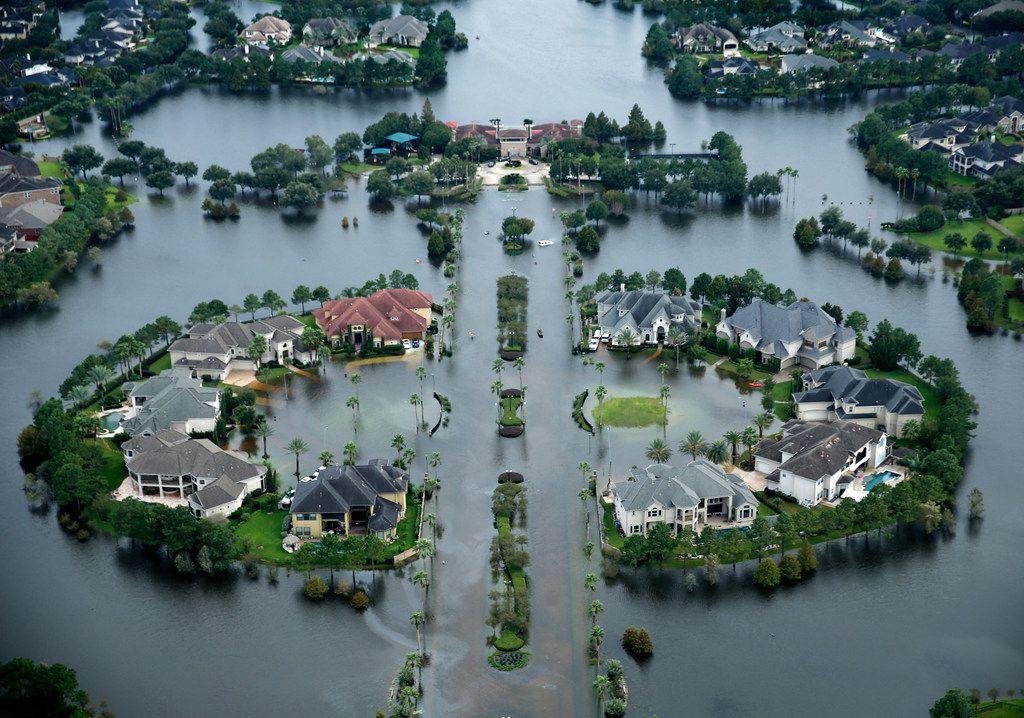 Flood waters have risen into the Lakes on Eldridge North neighborhood near the Addicks Reservoir  West Houston, Texas, Wednesday, August 30, 2017. Hurricane Harvey inundated the Houston area with several feet of rain.