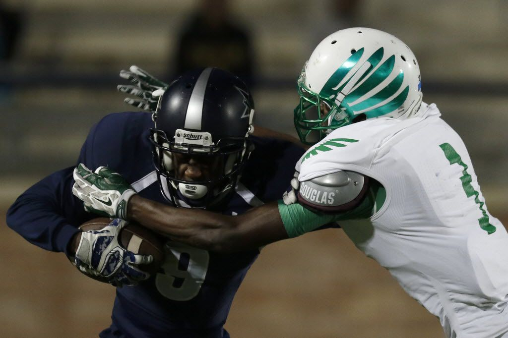 Frisco Lone Star Rangers Michael Johnson is tackled by Lake Dallas Falcons  Kobe Boyce in the 3rd quarter as Lake Dallas faces Frisco Lone Star at Eagle Stadium in Allen on Friday, Dec. 11, 2015. (Rachel Woolf/The Dallas Morning News)