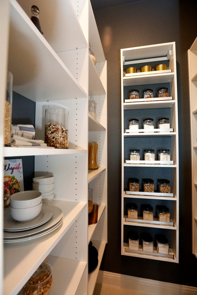 The home includes a walk-in pantry as well as another area with a wine fridge and more storage.