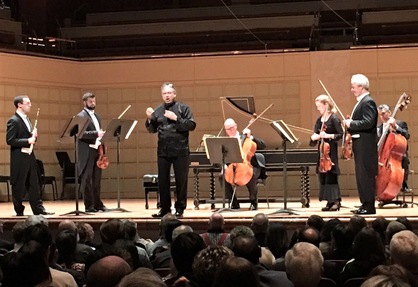 Guest conductor and harpsichordist Richard Egarr introduces a performance of Bach's Fifth Brandenburg Concerto with Dallas Symphony Orchestra musicians, left to right, David Buck (flute), Nathan Olson (violin), Christopher Adkins (cello), Barbara Sudweeks (viola), Gary Levinson (violin) and Nicolas Tsolainos (bass) at the Meyerson Symphony Center on March 22, 2018.