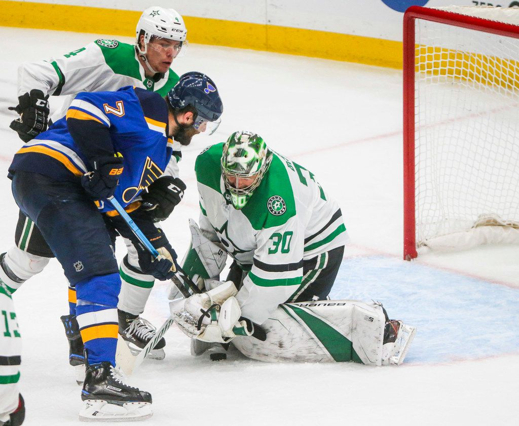 St. Louis Blues left wing Pat Maroon (7) takes a shot on Dallas Stars goaltender Ben Bishop (30) as he gets help from defenseman Miro Heiskanen (4) during the third period in game 5 of an NHL second round playoff series at Enterprise Center in St. Louis, Missouri on Friday, May 3, 2019.(Shaban Athuman/Staff Photographer)