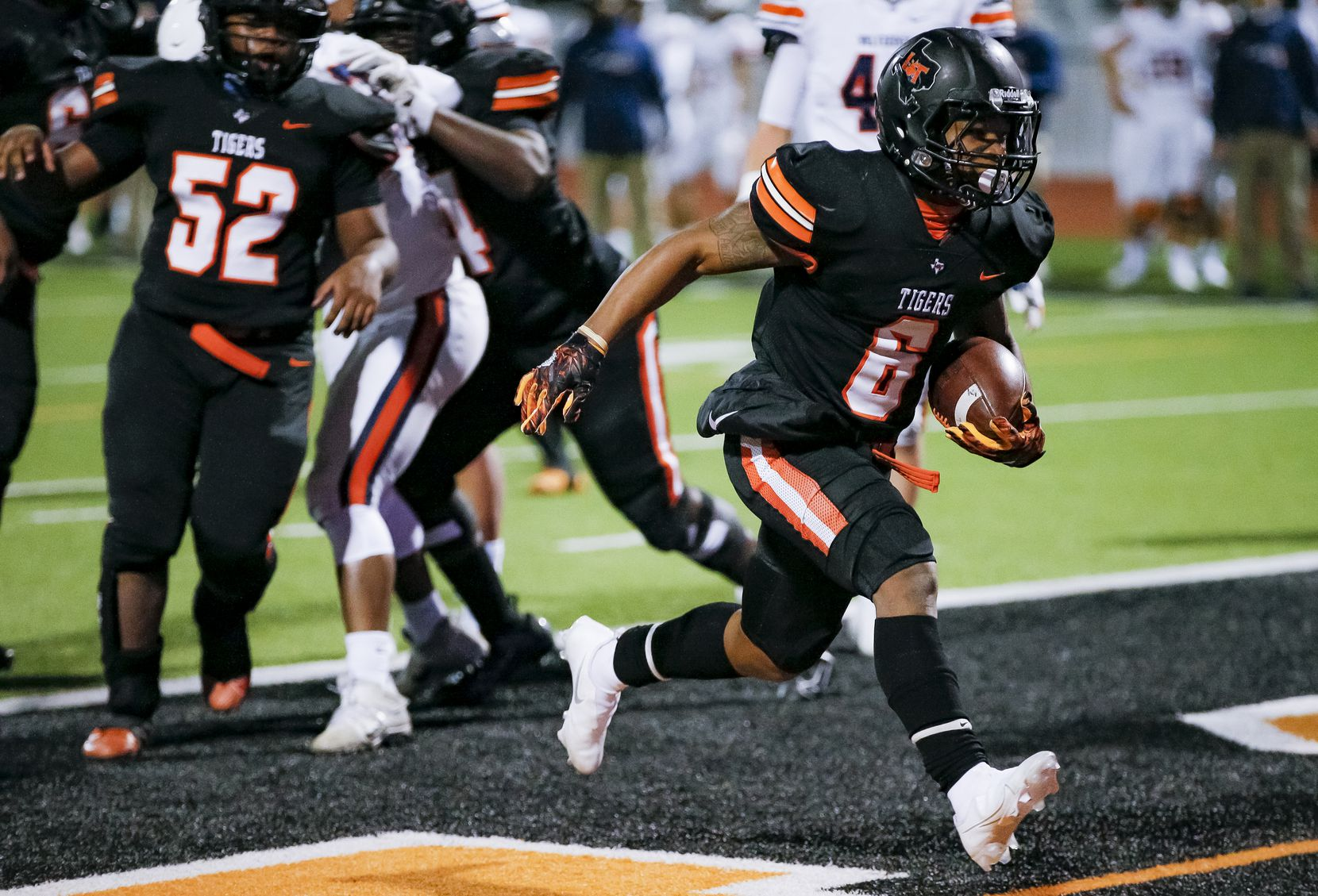Lancaster senior running back DQ James (6) scores touchdown during the first half of a class 5A Division I bi-district round playoff game against Wakeland at Tiger Stadium in Lancaster, Friday, December 11, 2020.