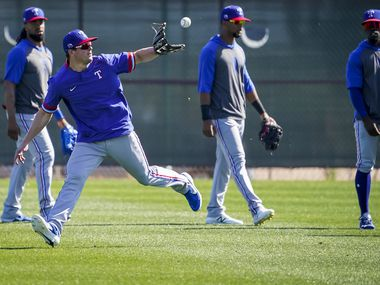 Texas Rangers infielder Nick Solak makes a catch while participating in a fielding drill during a spring training workout at the team's training facility on Thursday, Feb. 20, 2020, in Surprise, Ariz. (Smiley N. Pool/The Dallas Morning News)