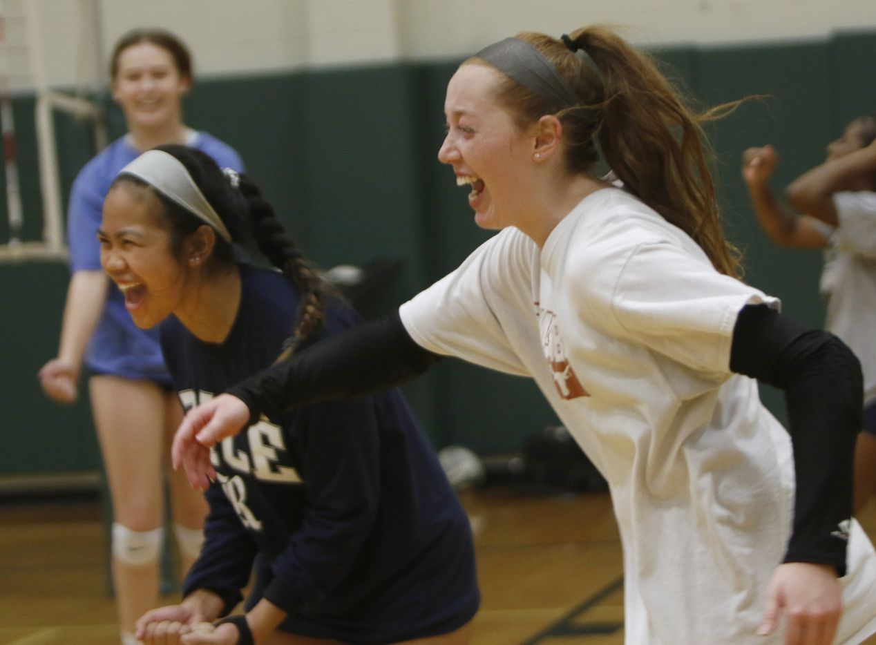 The first day of volleyball practice for the Lady Kats from Kennedale High School proved to be a hit from the euphoria displayed by Tatum Pavey, right, and Amaya Constantino as they scamper to congratulate a teammate after recording a point. Under the direction of head coach Kelly Carl, the team conducted their first practice of the season at Kennedale High School in Kennedale on August 03, 2020.(Steve Hamm/ Special Contributor)