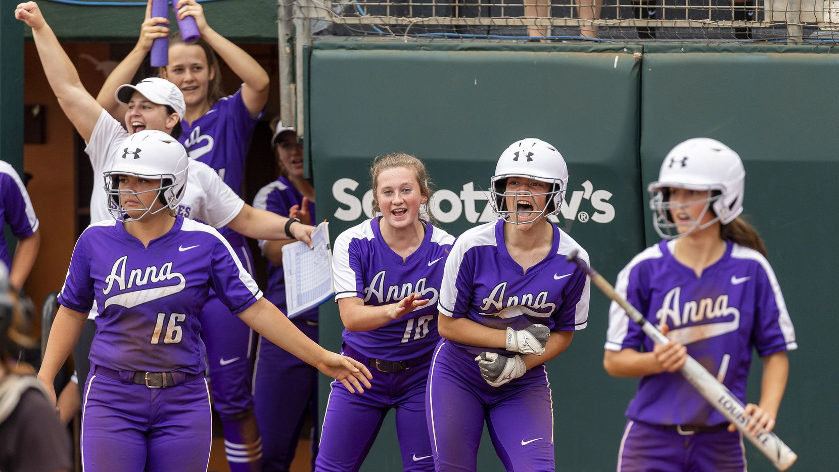 Anna runner Kallie Harris, center, celebrates scoring against Decatur during the UIL Class 4A state softball semifinal in Austin, Thursday, May 30, 2019. (Stephen Spillman/Special Contributor)