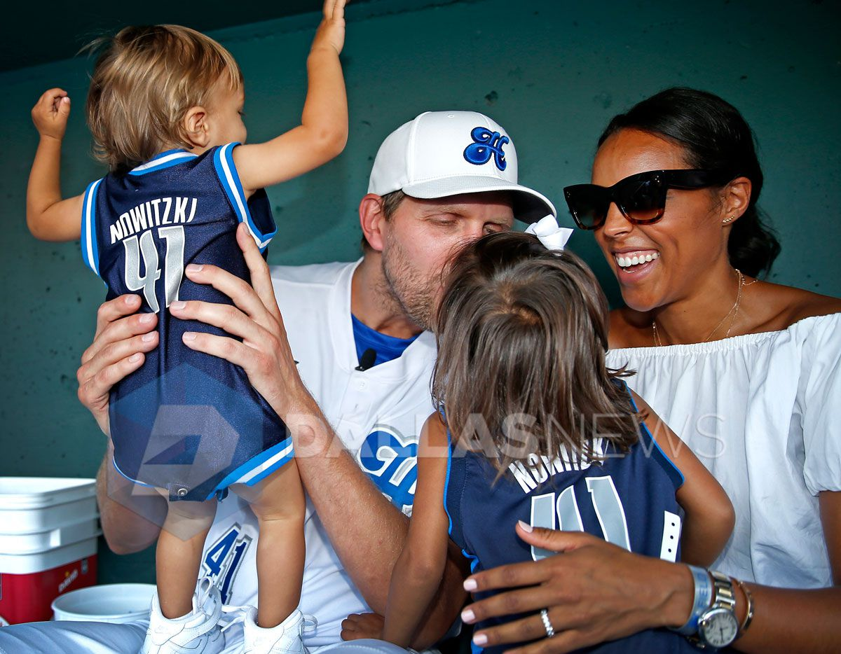 Dallas Mavericks Dirk Nowitzki kisses his 3-year-old daughter Malaika Nowitzki (second from right) as his wife Jessica Olsson (right) and son Max Nowitzki, 1, look on as the family poses for a photo in the dugout during the Dirk Nowitzki's 2016 Heroes Celebrity Baseball Game at Dr Pepper Ballpark on Friday, June 10, 2016, in Frisco, Texas.