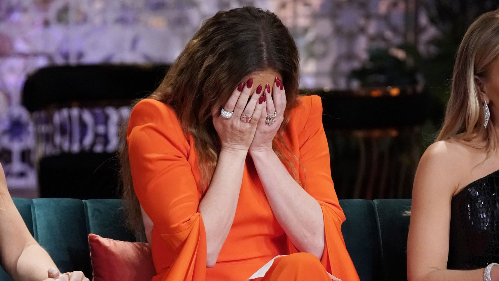 LeeAnne Locken puts her head in her hands and cries after Andy Cohen grills her about why she chose to use the word 'Mexican' so frequently to describe Kary Brittingham on Season 4 of 'Real Housewives of Dallas.'