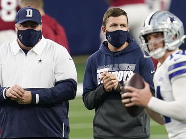 Dallas Cowboys head coach Mike McCarthy (left) and offensive coordinator coach Kellen Moore watch quarterback Andy Dalton warm up before an NFL football game against the Arizona Cardinals at AT&T Stadium on Monday, Oct. 19, 2020, in Arlington. (Smiley N. Pool/The Dallas Morning News)