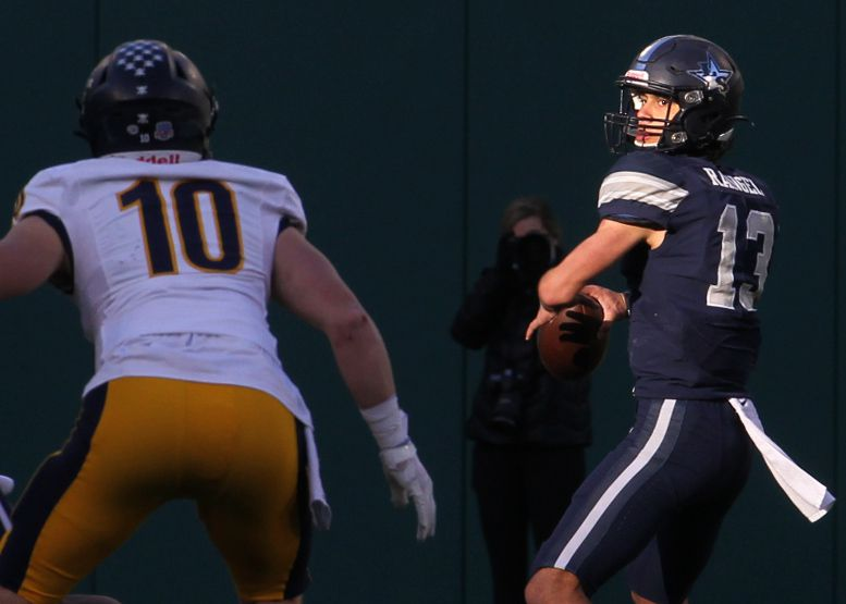 Frisco Lone Star quarterback Garret Rangel (13) looks to pass downfield as Highland Park defender Marshall Landwehr (10) moves in during first half action. The two teams played their Class 5A Division l Region ll semifinal football playoff game held at Globe Life Park in Arlington on December 24, 2020.