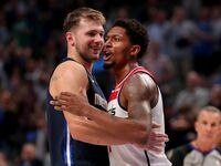 Bradley Beal of the Washington Wizards hugs Luka Doncic of the Dallas Mavericks after being ejected from the game in the fourth quarter at American Airlines Center on October 23, 2019 in Dallas, Texas.