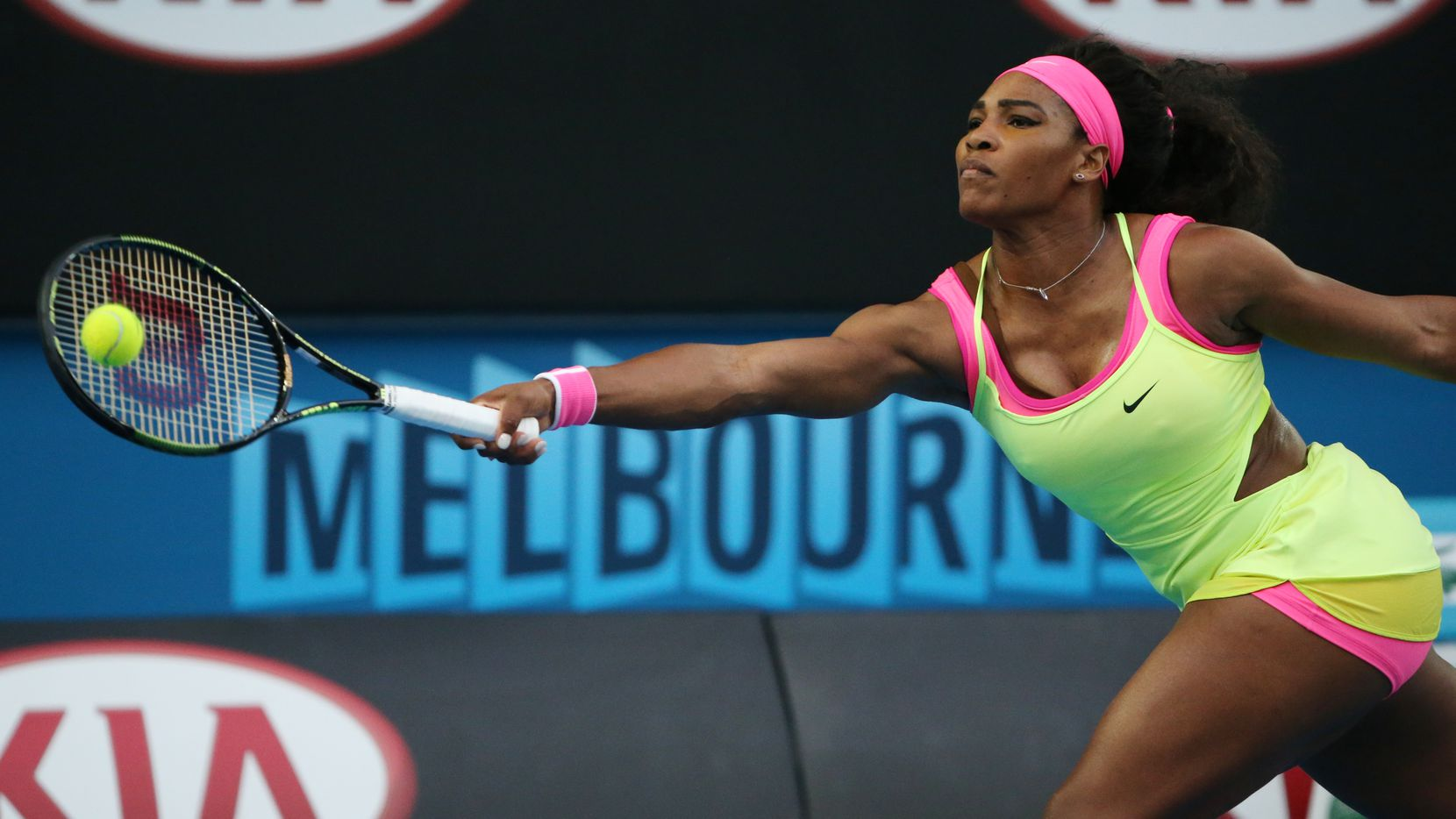 Serena Williams of the U.S. makes a forehand return to Alison Van Uytvanck of Belgium during their first round match at the Australian Open tennis championship in Melbourne, Australia, Tuesday, Jan. 20, 2015. (AP Photo/Rob Griffith)