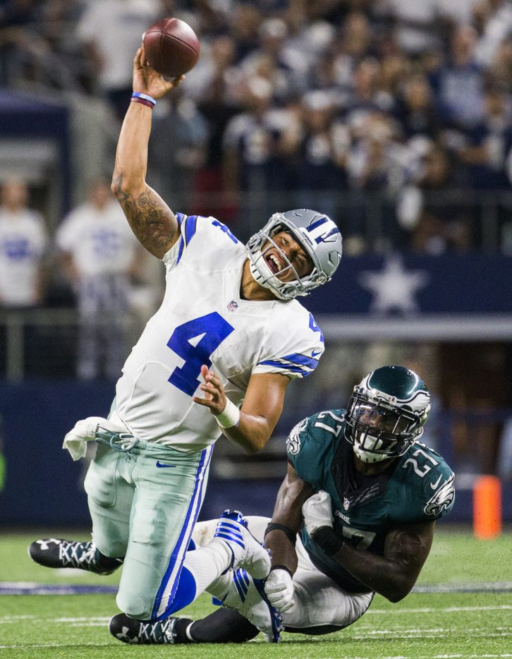 Dallas Cowboys quarterback Dak Prescott (4) throws a pass while being tackled by Philadelphia Eagles strong safety Malcolm Jenkins (27) during the fourth quarter of their game on Sunday, October 30, 2016 at AT&T Stadium in Arlington, Texas.