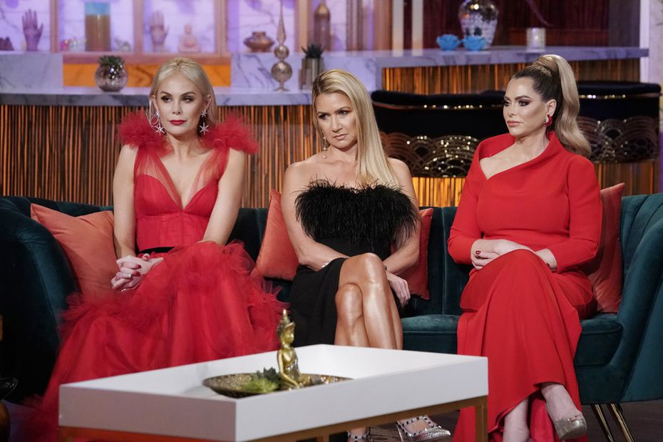 Kameron Westcott (far left), Kary Brittingham (middle) and D'Andra Simmons will return to 'Real Housewives of Dallas,' Season 5. They're pictured here during the Season 4 finale with Bravo's Andy Cohen.
