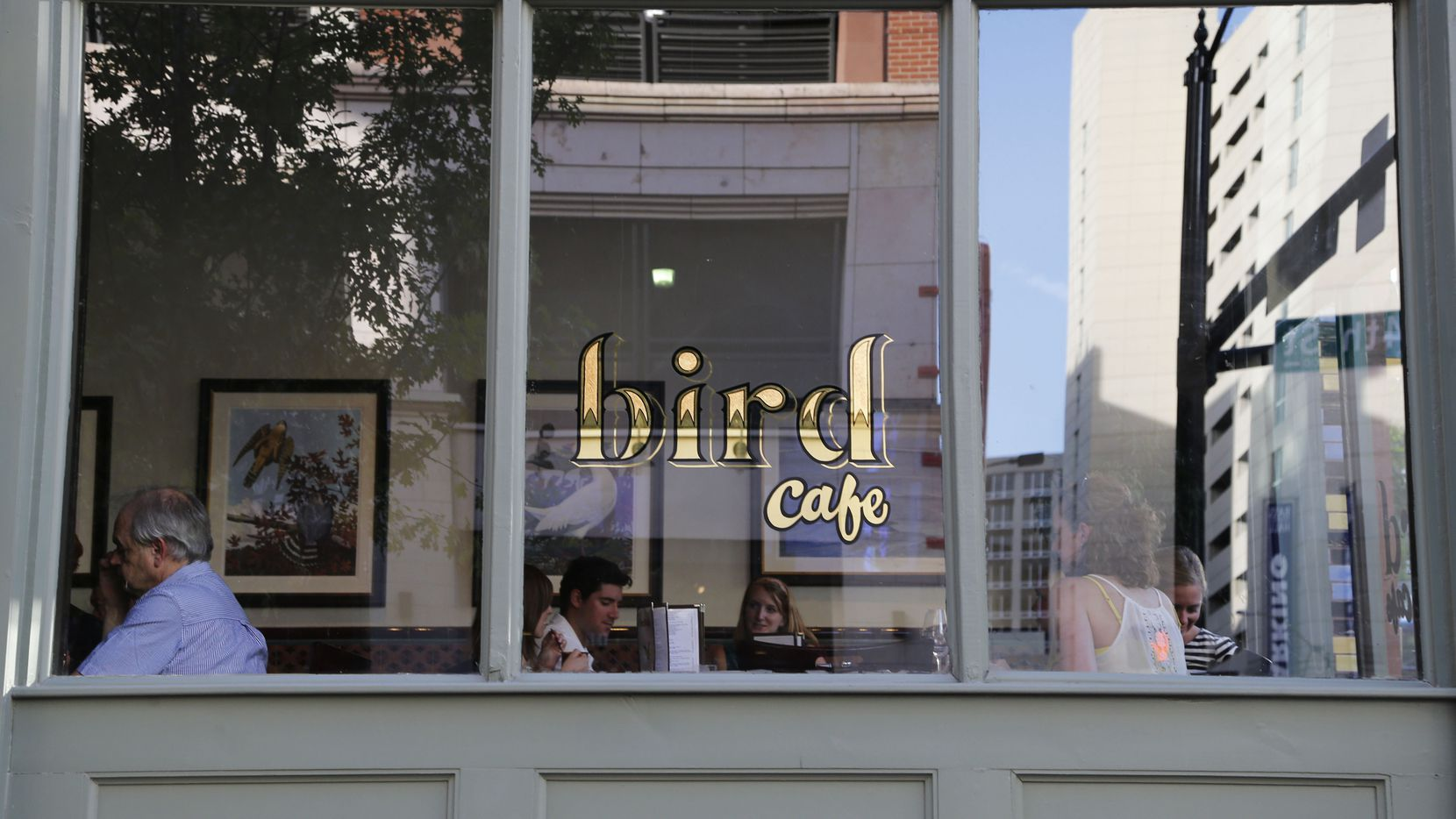 Diners converse and eat dinner at Bird Cafe in Fort Worth in June 2014.