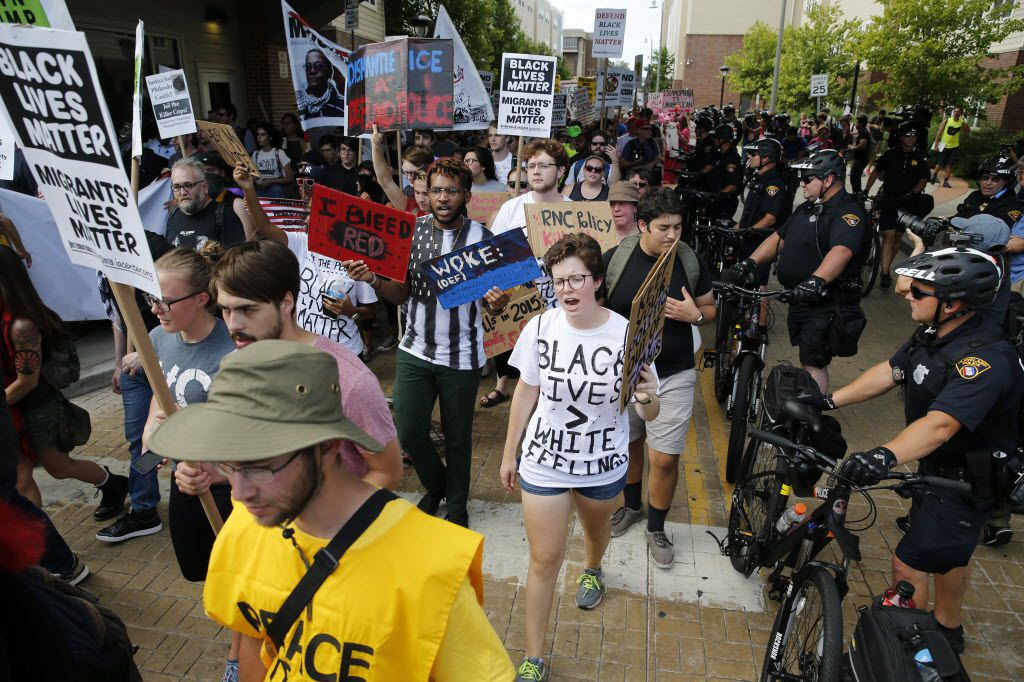 Protesters march downtown in a fight against Trump as police attempt to keep them on one side of the road before the start of the Republican National Convention in Cleveland, Ohio on Sunday, July 17, 2016. (Vernon Bryant/The Dallas Morning News)